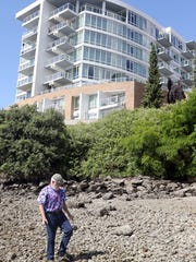 Bremerton Harborside condos resident Rich Chwaszczewski is worried that the bank on the beach side is at risk from a collapse.