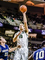MSU's Matt Costello shoots the ball in over Chris Patureau