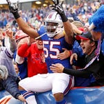 Jerry Hughes re-signs with Bills