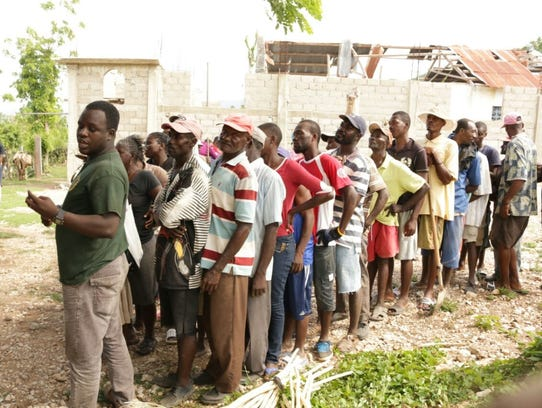 People in Haiti line up to get food. Missionaries of