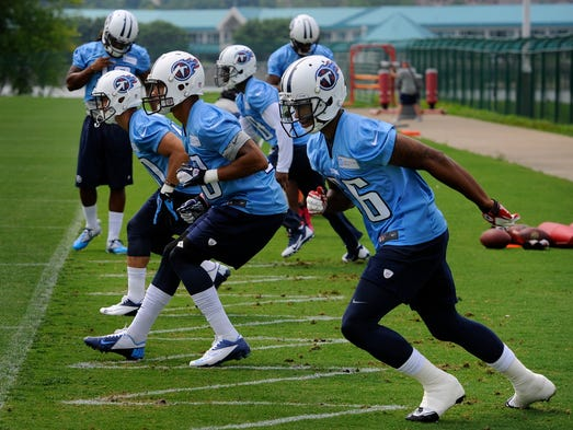 Titans defensive backs run drills during practice at St. Thomas Sports Park Tuesday May 27, 2014, in Nashville, Tenn.