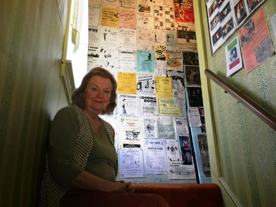 Judy McMahon at home on the West Side of Binghamton, where her stairwell wall is covered with fliers from all the plays she's been in and directed. McMahon is the host of The Hungry Ear at the Broome County Public Library.