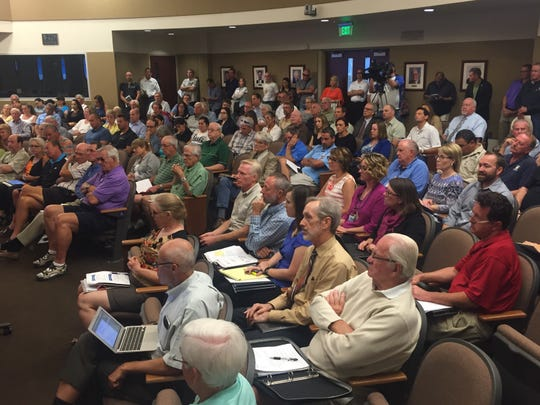 A large audience listens to a presentation during a meeting of the Coachella Valley Water District's board on Tuesday in Palm Desert.