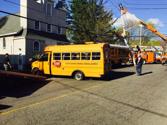 A mini bus for East Ramapo School District, foreground, after it was struck by a full sized Yeshiva Avir Yakov bus that ran a stop sign at West and Church streets in Spring Valley. The mini bus was pushed about 40 feet into a utility pole. The pole cracked as the smaller bus went into a church's iron fence. The East Ramapo driver complained of body pain and was taken to Nyack Hospital by Spring Hill Ambulance Corps.