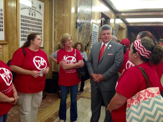 Opponents of Common Core from Rapides Parish speak with Rep. Lance Harris outside the House Chamber in the Louisiana State Capitol in Baton Rouge on Wednesday.