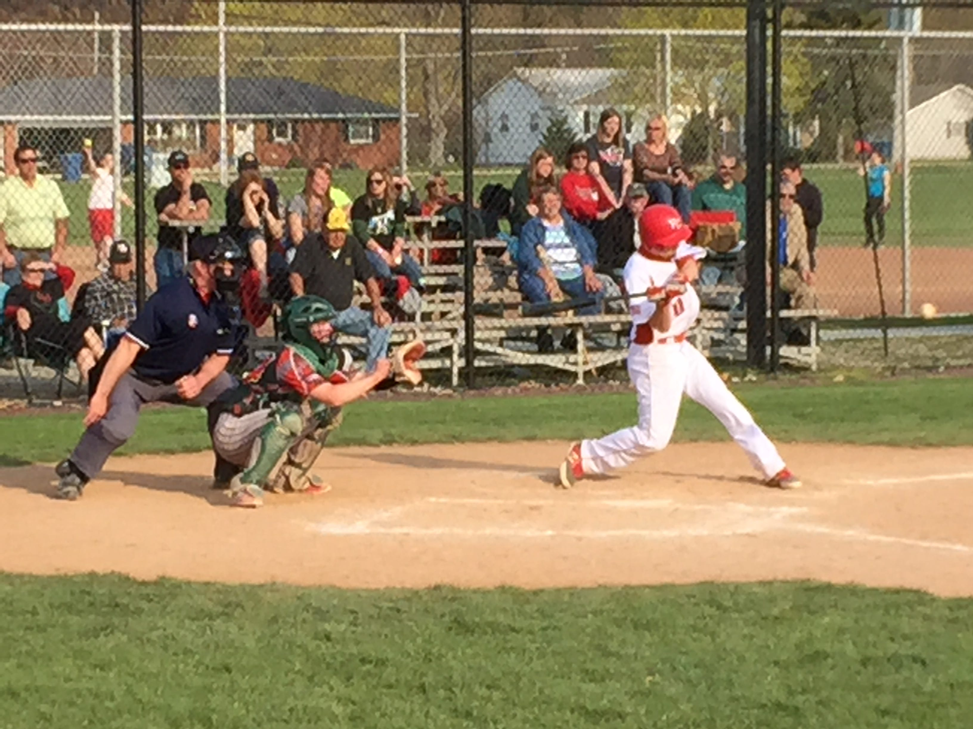 Port Clinton's Trevor Monk swings at a pitch Wednesday against Oak Harbor.