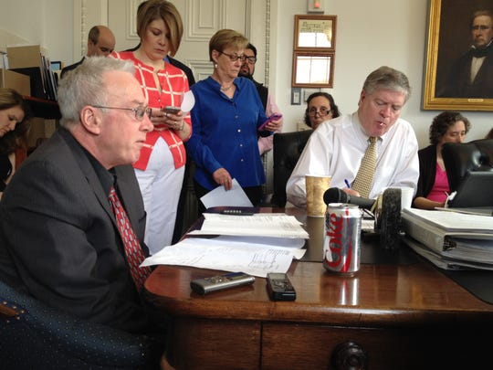 Vermont Finance Commissioner Jim Reardon, left, presents about $8 million in budget reduction proposals to a packed Senate Appropriations Committee meeting on Thursday morning.