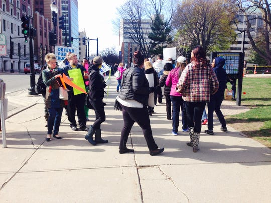 Detroit teachers protest in front of the Capitol in Lansing on Thursday, April 30, 2015.