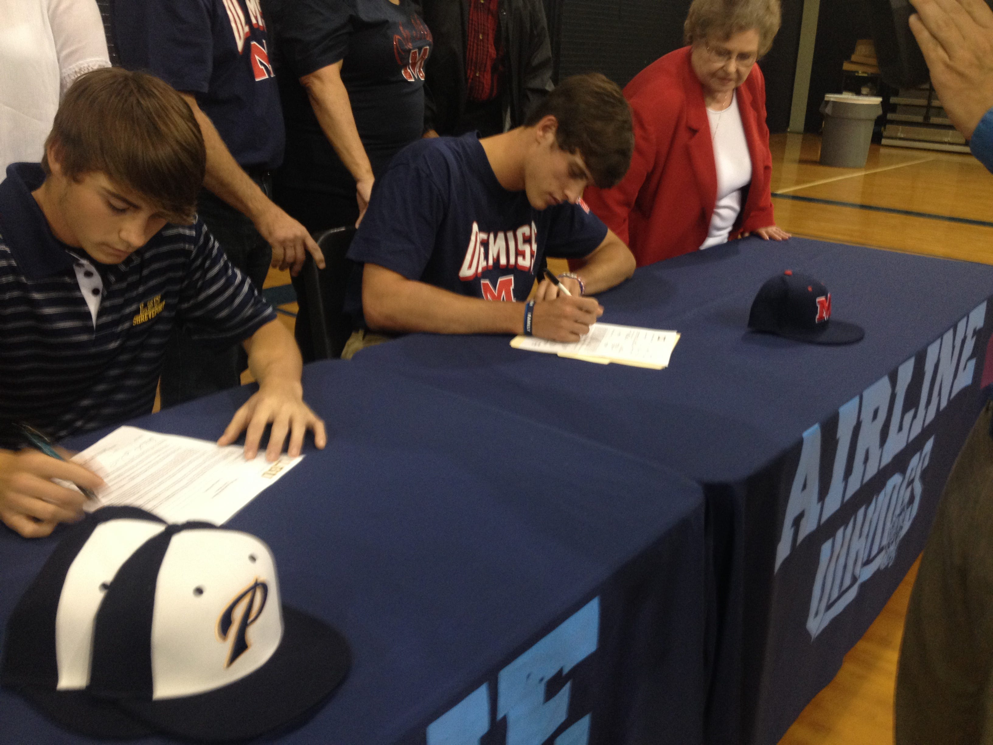 Airline baseball players Tanner Daniel (LSUS) and Andrew Lowe (Ole Miss) sign scholarship papers Wednesday.