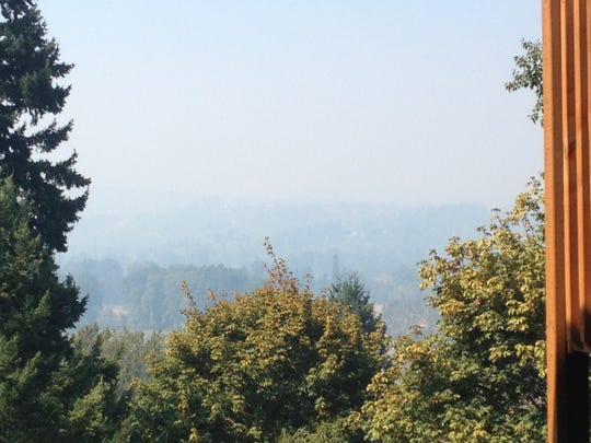 A view of West Salem from Rural Avenue in South Salem in September 2014 shows smoke and haze hovering above the Willamette Valley due to a temperature inversion.