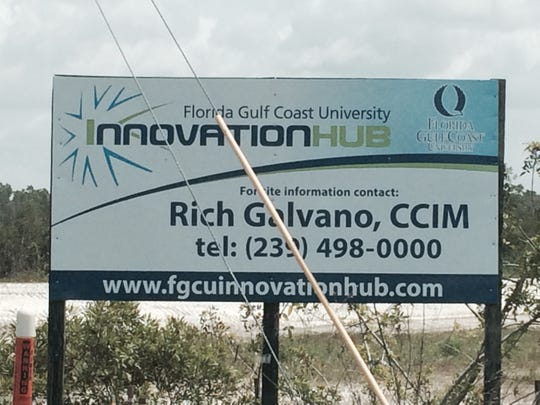A sign at the Innovation Hub, under construction off Alico Road.