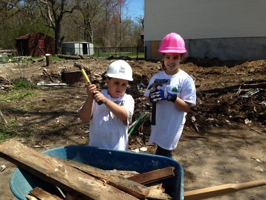 Joel Paulino and Alexa Paulino are eager to help rebuild their grandmother Ana Henn's home in Port Monmouth. Habitat for Humanity Monmouth County is rebuilding the Sandy-ravaged home.