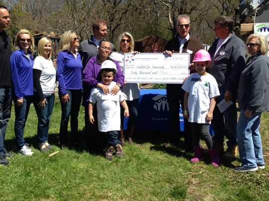 Hope for Children Foundation presents a $40,000 check to Habitat for Humanity Monmouth County. Holding the check are Marybeth Walz of Hope for Children and Ray Gabler of Habitat.