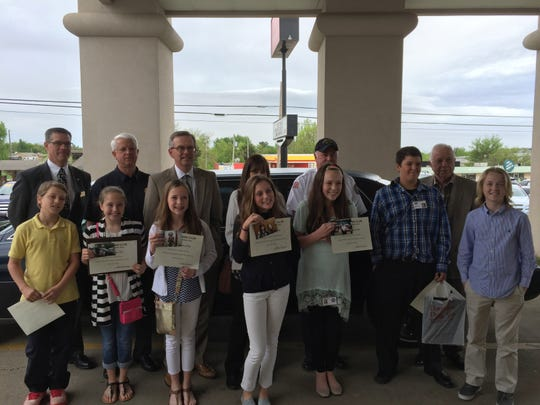 Students and officials who participated in Kiwanis Club Student Government Day are: from left, front row, Hayden Bahr, Mattie Belk, Emma Martin, Katie Claire Stewart, Sophie Quick, Dawson Tabor and Wyatt Gilbert; back row, Todd McCoy of Roller Funeral Home, Police Chief Carry Manuel, City Attorney Roger Morgan, City Treasurer Debbie Cotter, Fire Chief Ken Williams, Mayor Joe Dillard.