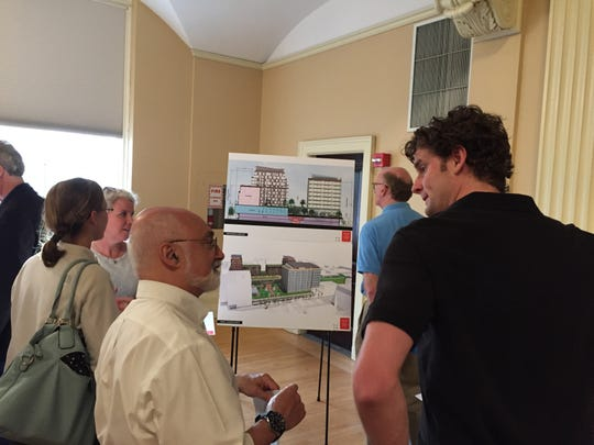 Members of PKSB Architects gather at drawings of the proposed changes to Burlington Town Center mall Tuesday night  at Contois Auditorum at Burlington City Hall.