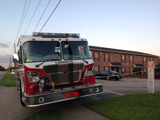 A fire truck and police tape block the entrance of Bell Downs Apartments Tuesday evening. Some of the apartment complex was evacuated after police found what they believe to be explosive devices in an apartment.