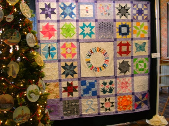 This quilt from a past show was created by members of the Wayne County Extension Homemakers in honor of their friends and families affected by cancer.