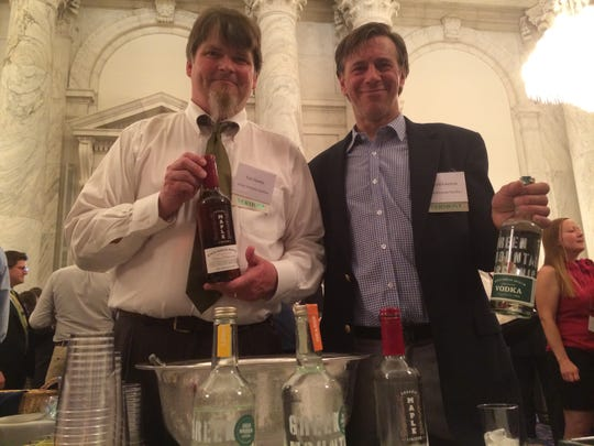 Tim Danahy, left, and Harold Faircloth, co-owners of Green Mountain Distillers, show their products at the Taste of Vermont reception.