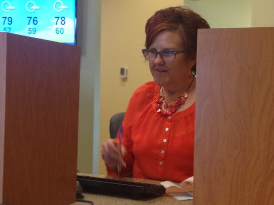 Mary Cooper, teller, works on Wednesday afternoon at First Financial Credit Union's new branch in Freehold Township.