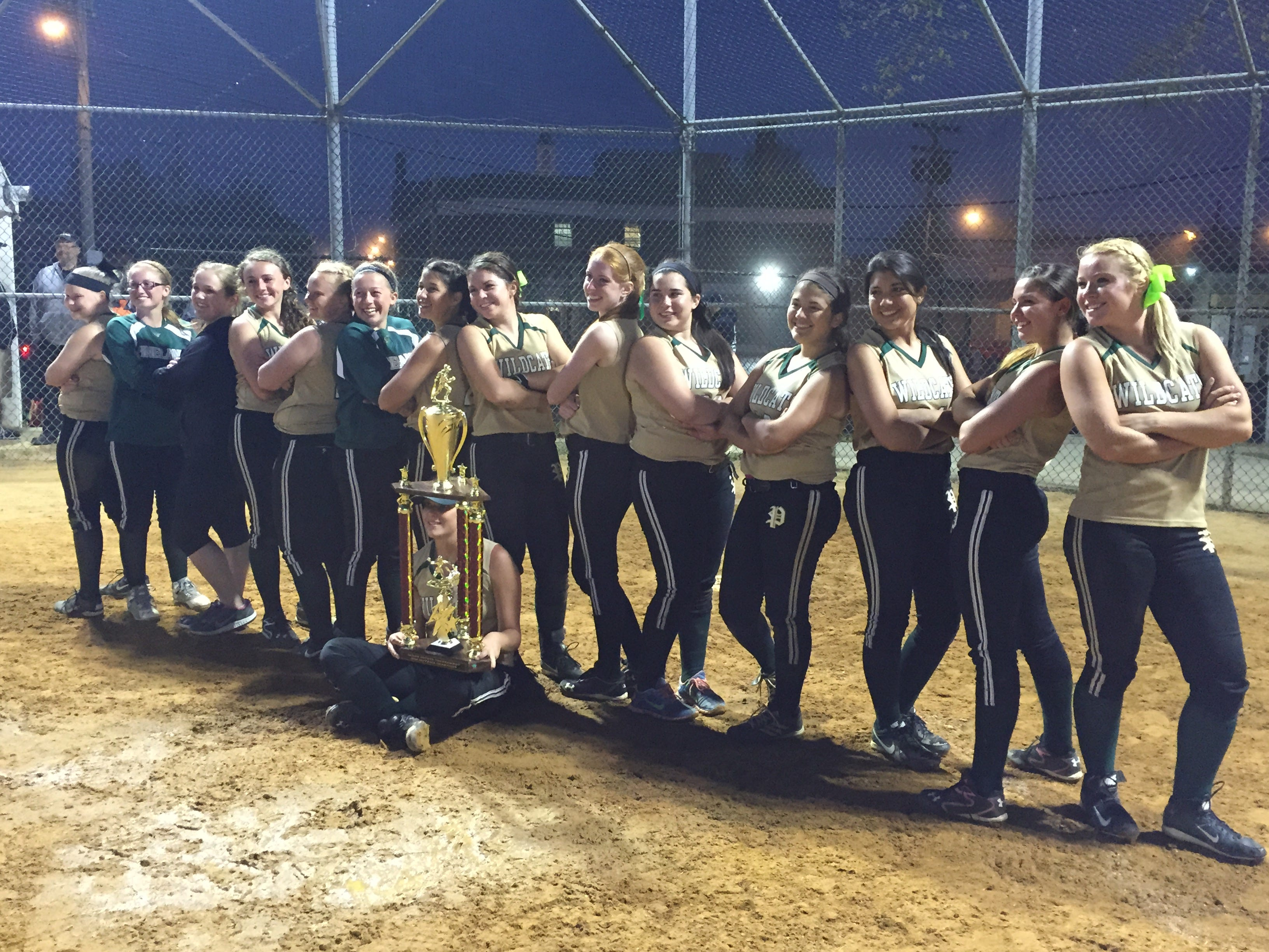 The Pinelands softball team displays the championship trophy after defeating Southern, 10-0, in the Ocean County Tournament final on Saturday night, May 9, 2015