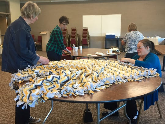 Volunteers gather Saturday, May 9, to sew handmade blankets for Alexia's Cozy Covers, a nonprofit that donates blankets for youth and families in need.