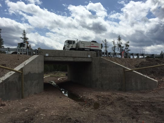 A truck crosses an wildlife underpass on Highway 200.