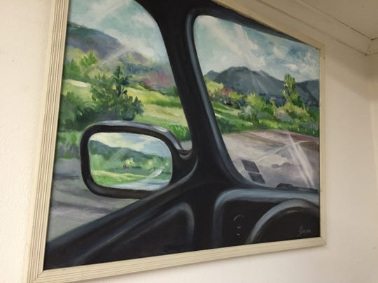 One of Marian Simpson's paintings depicts a view from out the window of her motor home.