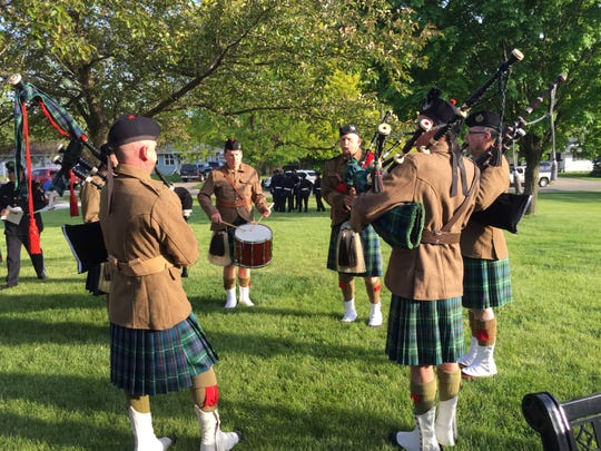 Members of MacKenzie's Highlanders perform at the Peace Officer Memorial Service on Tuesday at Aldersgate United Methodist Church in Urbandale. The main goal of MacKenzie's Highlanders is to support and honor active and reserve military unit, law enforcement agencies and fire departments.