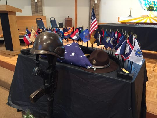 Flags honor law enforcement officers from across the nation who died in the line of duty during during the Peace Officers Memorial Service on Tuesday at Aldersgate United Methodist Church in Urbandale.