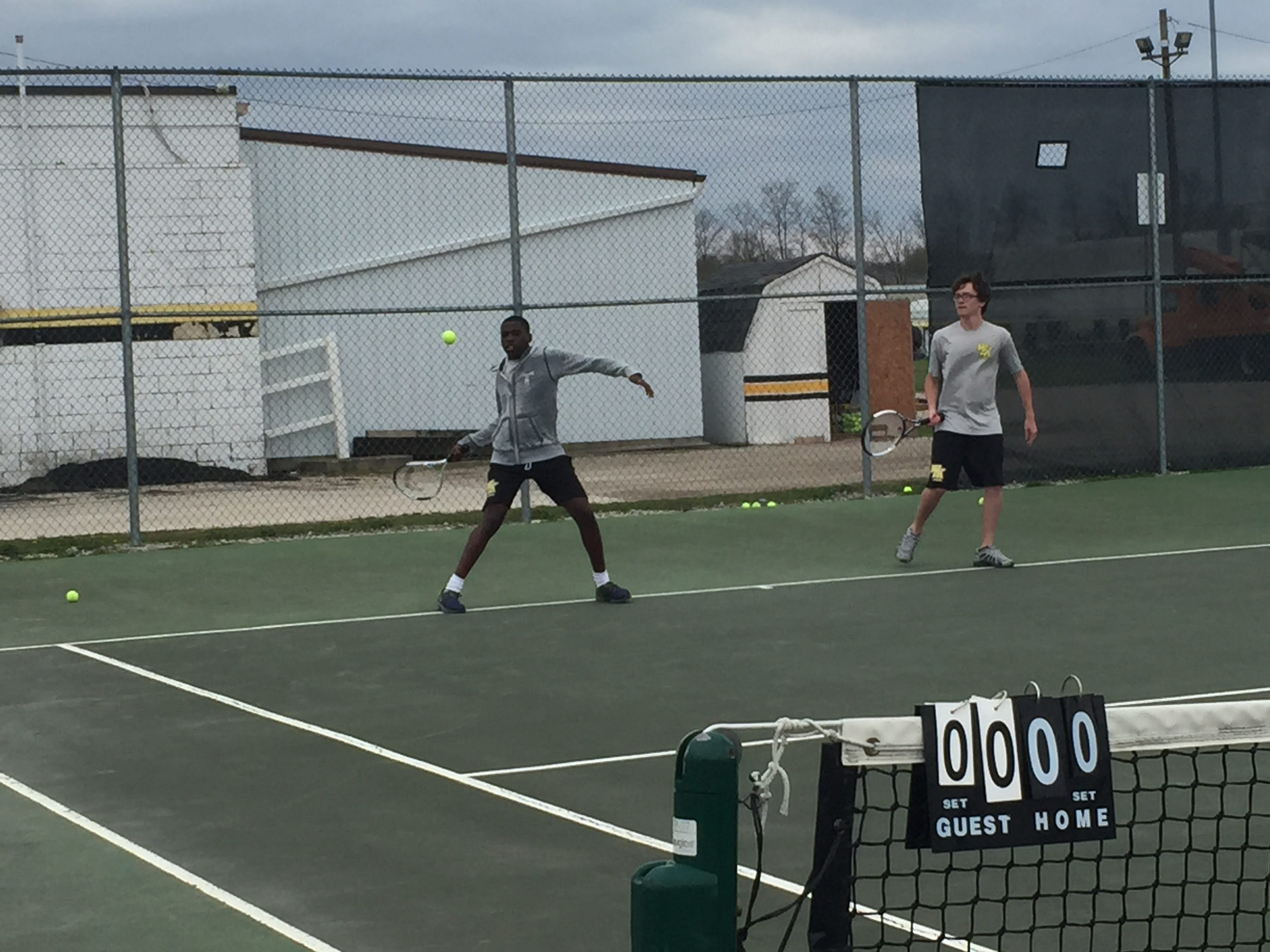 Watkins Memorial's D.J. Davis, left, drills before a recent match. Davis and junior Robert Speaks have had a strong season at No. 1 doubles for the Warriors.