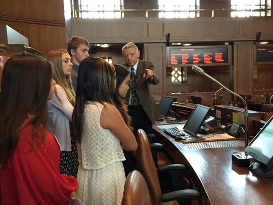 Chuck Bradish gives a group of students participating in the Oregon Senate's honorary page program a rundown on what happens on the floor during a session.