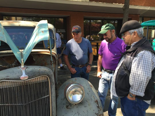 Attendees of the 27th annual Visalia Breakfast Lions car show check out a 1935 Ford pickup truck with a diesel engine Saturday in downtown Visalia.