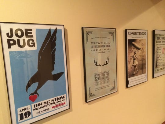 Posters of past Billsville House Concerts shows line the walls at Doug Hacker's home in Manchester Center.