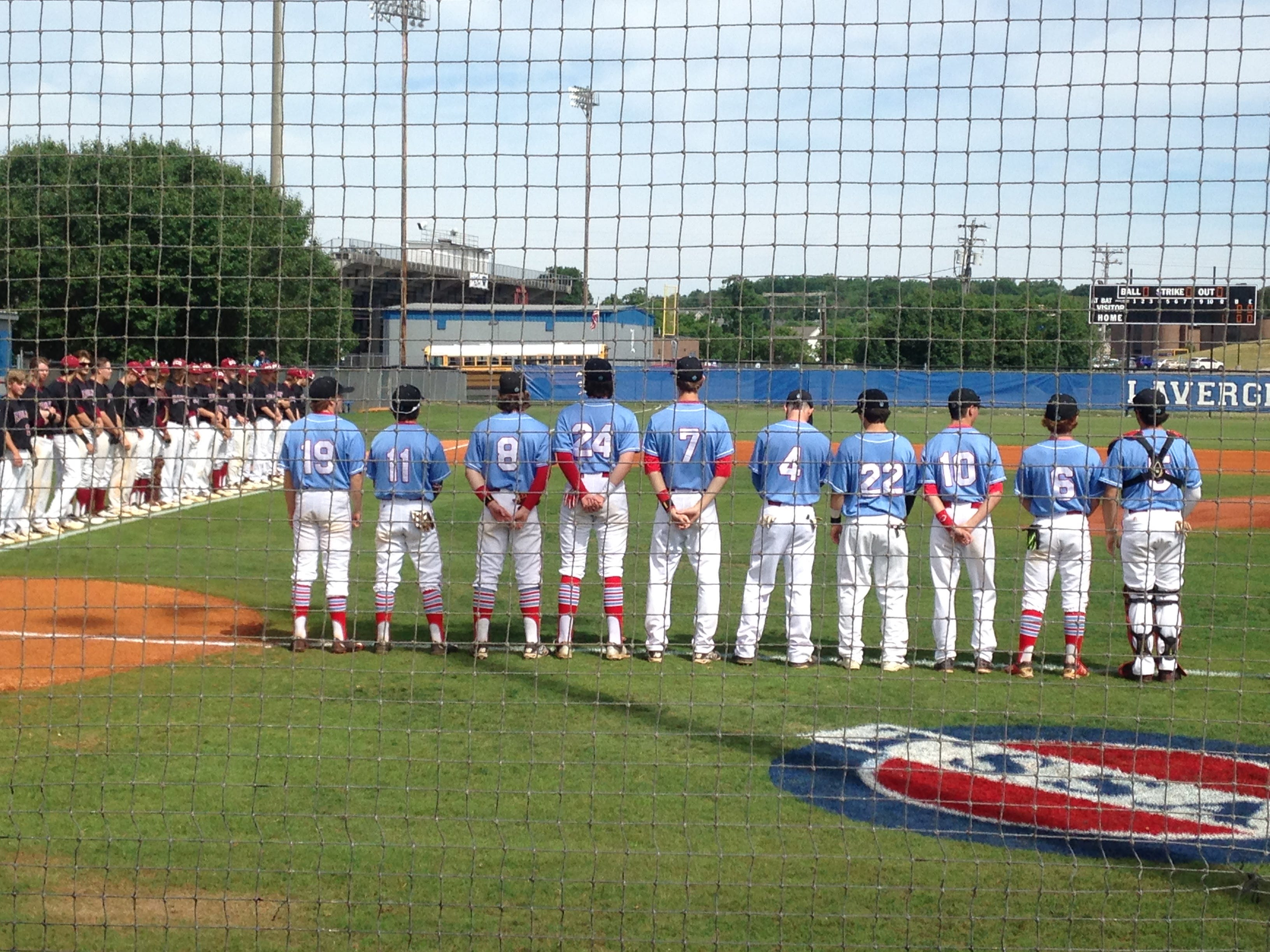 USJ players line up for the national anthem before a state tournament game Wednesday against ECS.