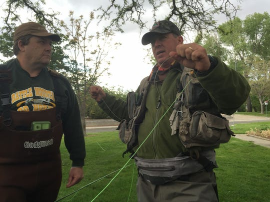 Guide Mike Sexton, a former member of the U.S. Fly Fishing team, helps Shannon Jackson of Reno prepare for a fishing lesson on the Truckee River.