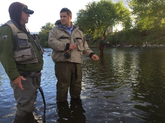Guide Mike Sexton from Reno Fly Shop explains fishing techniques to John Gremp, 32, of Reno, during a recent fly fishing lesson.