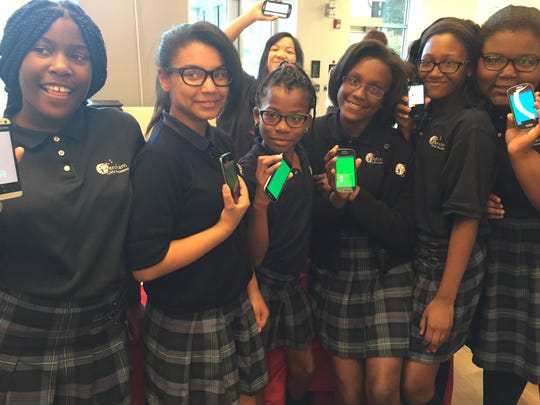 Students from the Serviam Girls Academy near Wilmington show off the apps they created as part of the Capital One Coders program. Pictured are (from left) Saniah Frazier, Zoe Abe, Shay-Lee Hall (rear), Annissa Taylor, Diamond Wilson, Breajah Bordley and Kirah Ruffin.