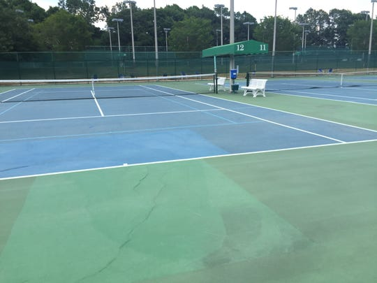 Courts 12 and 13 at the Roger Scott Tennis Center were closed for competitive play this week because of the playing surfaces' conditions.