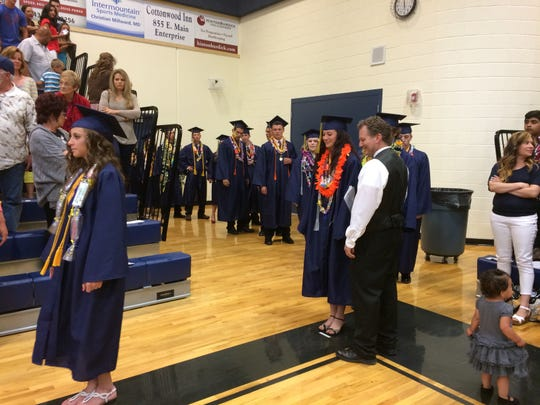 The class of 2015 marches into the gymnasium at Enterprise High School for their commencement ceremony Thursday.