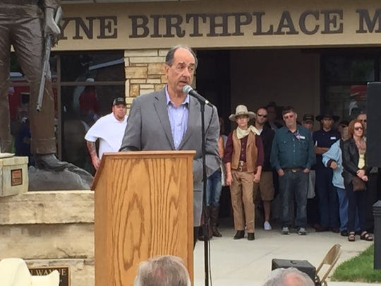"""Scott Eyman, author of """"John Wayne: The Life and the Legend,"""" spoke about the qualities of John Wayne and what makes him an American icon to many at the grand opening of the John Wayne Birthplace Museum in Winterset on Saturday."""