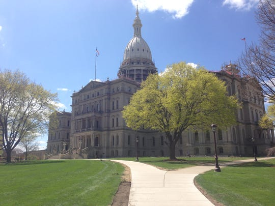 Michigan's tax revenues will remain relatively flat over the next three years, according to the state's two fiscal agencies.