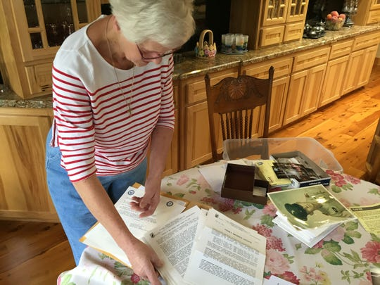 Yvonne Sanders of Silverton sifts through letters, reports and photographs pertaining to her brother, Army Warrant Officer Gerald Woods, who was killed Feb. 18, 1971 during the Vietnam War.
