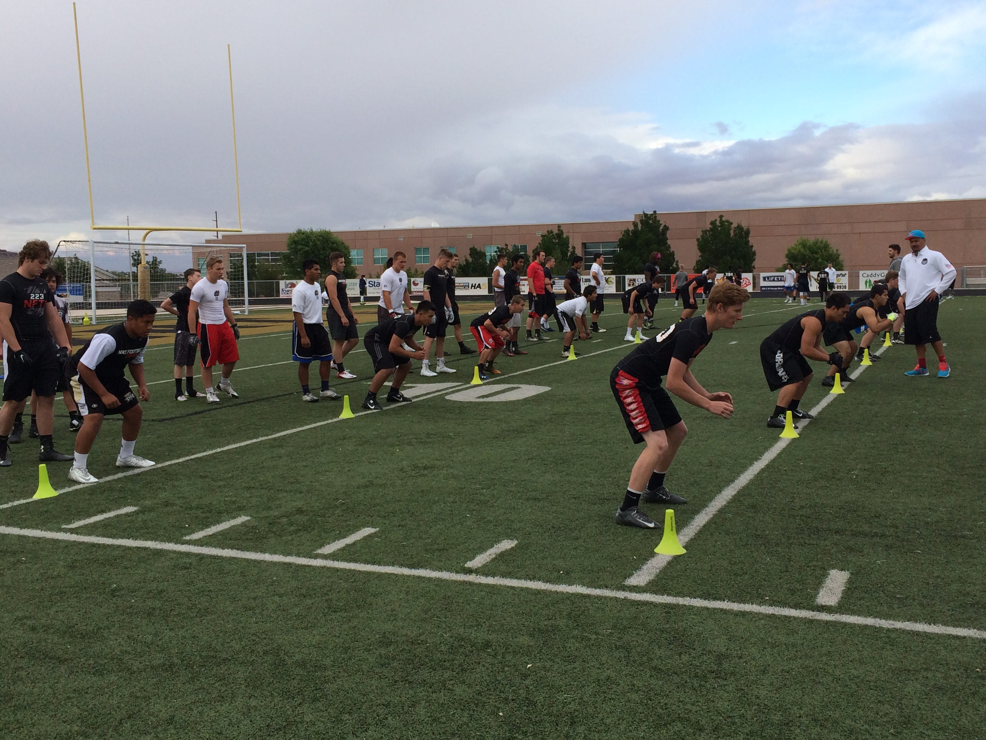 Players work on drills at the All Poly Camp at Desert Hills High School on Friday.