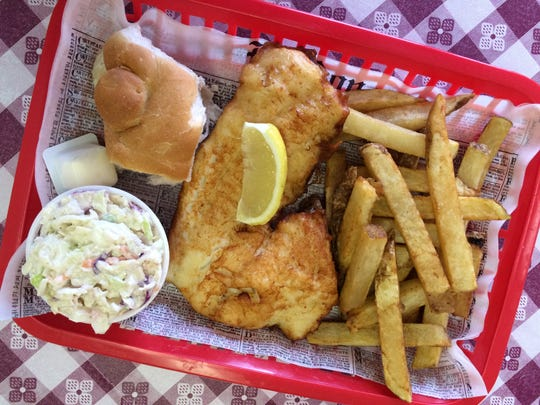 The King size fish and chips from OK UK Fish-n-Chips in North Fort Myers, made with an 8.5-ounce fillet of Icelandic cod, hand-cut chips (aka: fries), cole slaw and a roll.