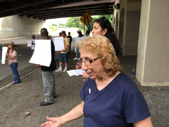 Sister Grace Miller, co-founder of House of Mercy, with homeless advocates under the Douglass-Anthony Bridge on May 29, 2015.