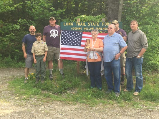 Six people joined Dorothy Wescom on a hike up Laraway Mountain Saturday morning. Wescom, center, holds the Purple Heart medal engraved with her father's name. Her father, Cedric C. Laraway, was killed in action during World War II.