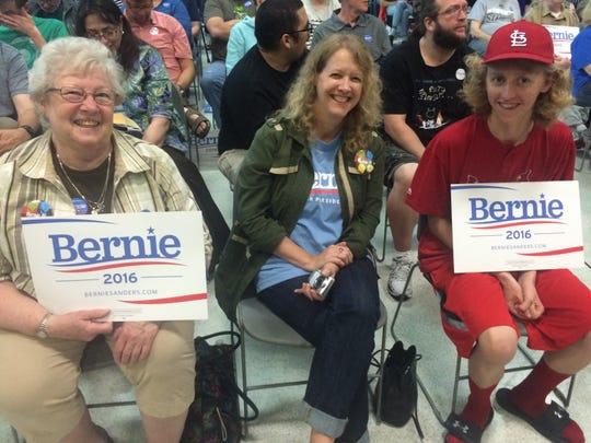 Elizabeth DeBrower, left, of Cedar Rapids sits with her daughter Jana DeBrower and her grandson Julian DeBrower sit in the front row of seats in the social hall of the Robert A. Lee Recreation Center in Iowa City Saturday morning to see presidential hopeful Sen. Bernie Sanders, I- Vt.