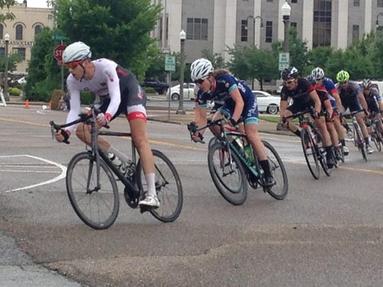 Cyclists turn off of Lafayette Street during a criterium Sunday afternoon in Jackson. Slick roads created an extra challenge for Sunday's races.