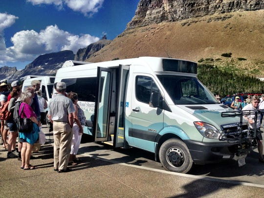 Visitors at Glacier National Park board a free shuttle at Logan Pass.