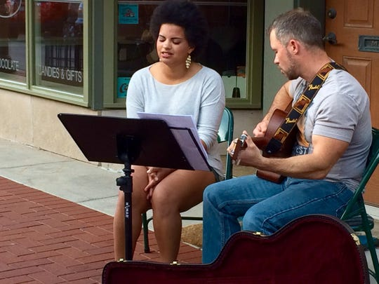 One of around 15 different musical acts performs Thursday